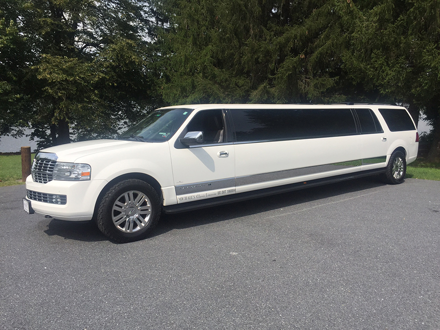 White Stretch Lincoln Navigator outside