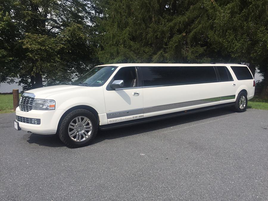 White Stretch Lincoln Navigator outside